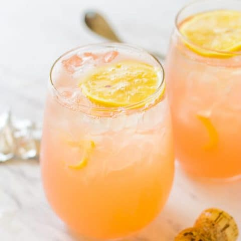 Close up of 2 Grapefruit Lemonade Crush Cocktails sitting on a white table