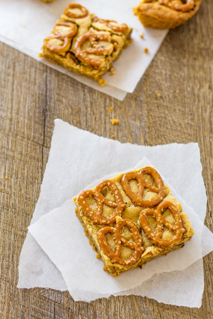 These peanut butter pretzel bars are overflowing with goodness as well as bacon and bourbon! | Take Two Tapas | #PeanutButter #Pretzels #PeanutButterBars #BrownieRecipe #Bacon #PeanutButterRecipes