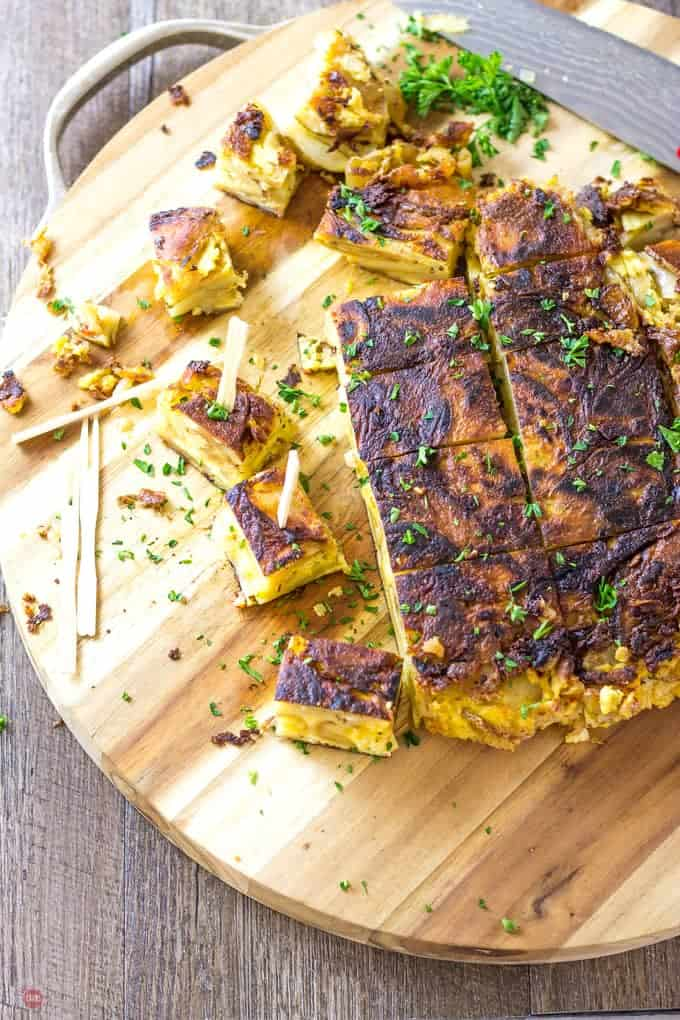 overhead of Tortilla Espanola with Pimento Cheese on a wooden cutting board