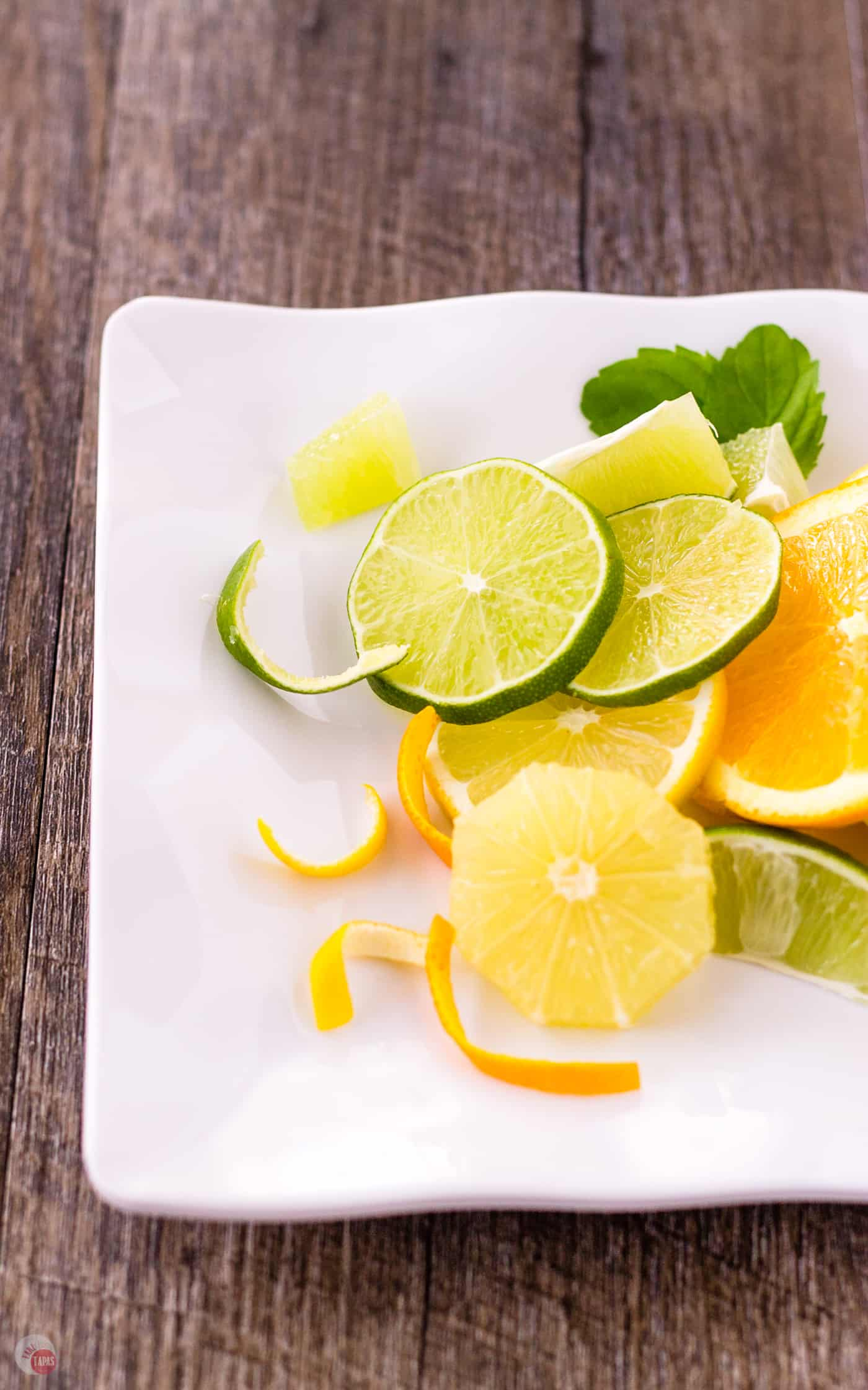 slices of Oranges, Lemons, Limes on a plate