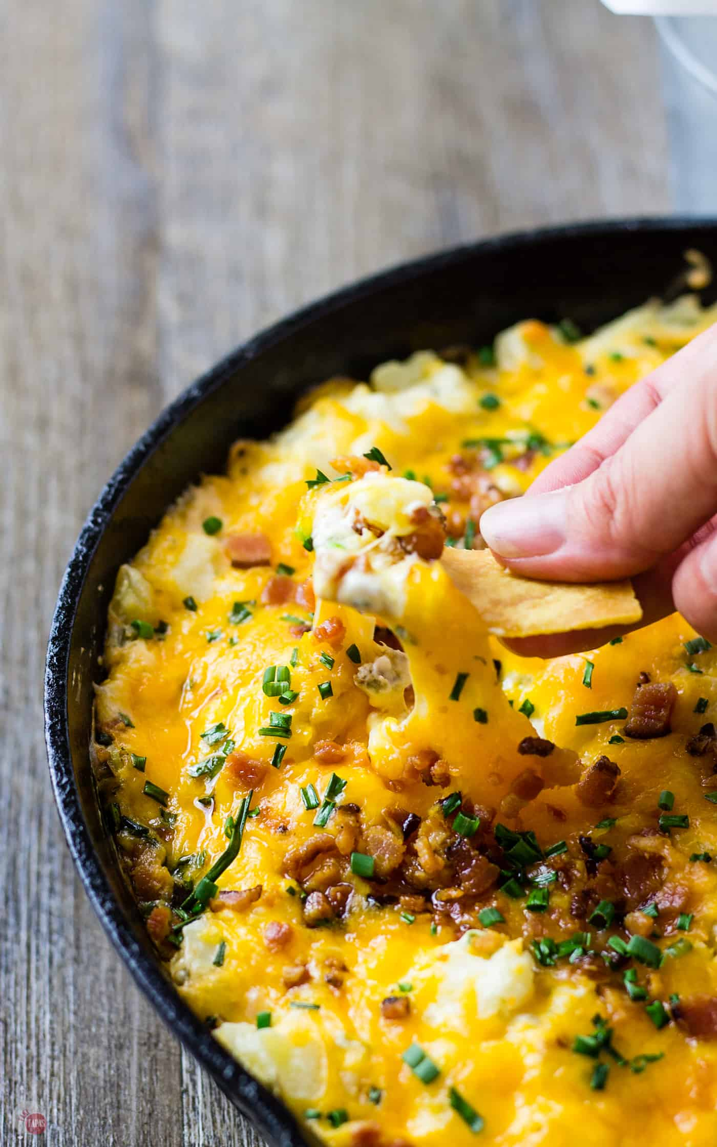 Like Potato Skins? Check out my Loaded Potato Skin Dip made in a skillet! | Take Two Tapas | #LoadedPotatoSkins #PotatoSkins #SkilletDip #Tailgating #Bacon #Potatoes #Cheese