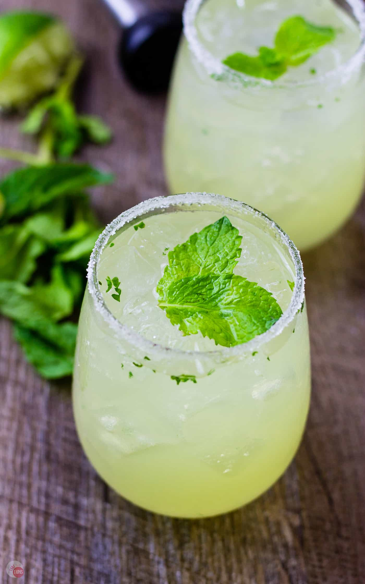 The gorgeous colors of green and yellow are highlighted with the mint leaves in my Mariachi Mash | Take Two Tapas | #Limoncello #Lime #Tequila #Cocktails #SummerEntertaining #EasyCocktails