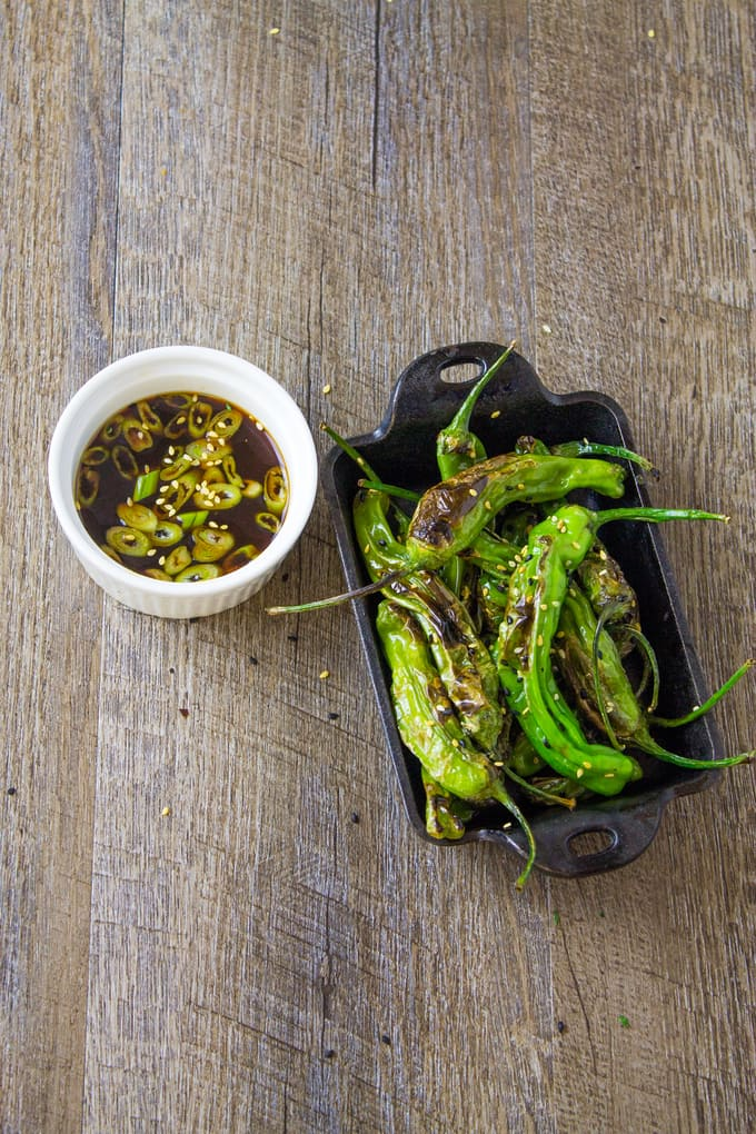 My pan blistered shishito peppers take less than 5 minutes to make and are great with a ginger ponzu sauce! | Take Two Tapas | #ShishitoPeppers #ShishitoRecipe #Peppers #Ponzu #FingerFoods