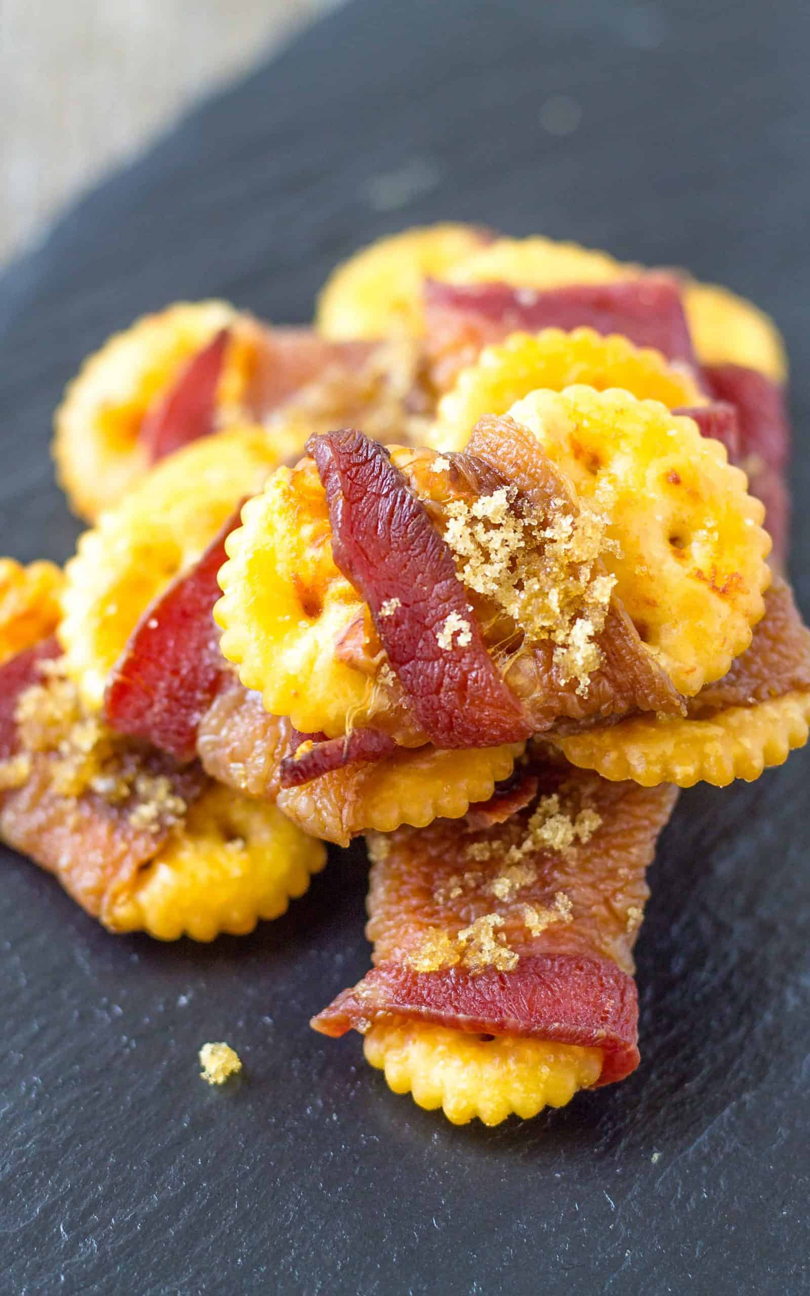 Sweet and Spicy Bacon Crackers on a black plate