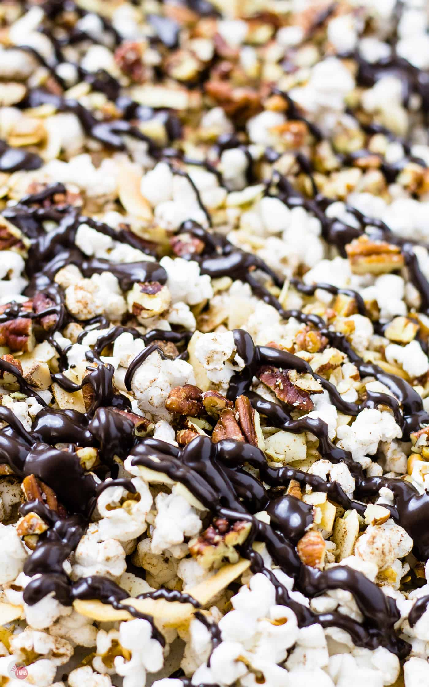 Check out this chocolate drizzle on my German Chocolate Popcorn | Take Two Tapas