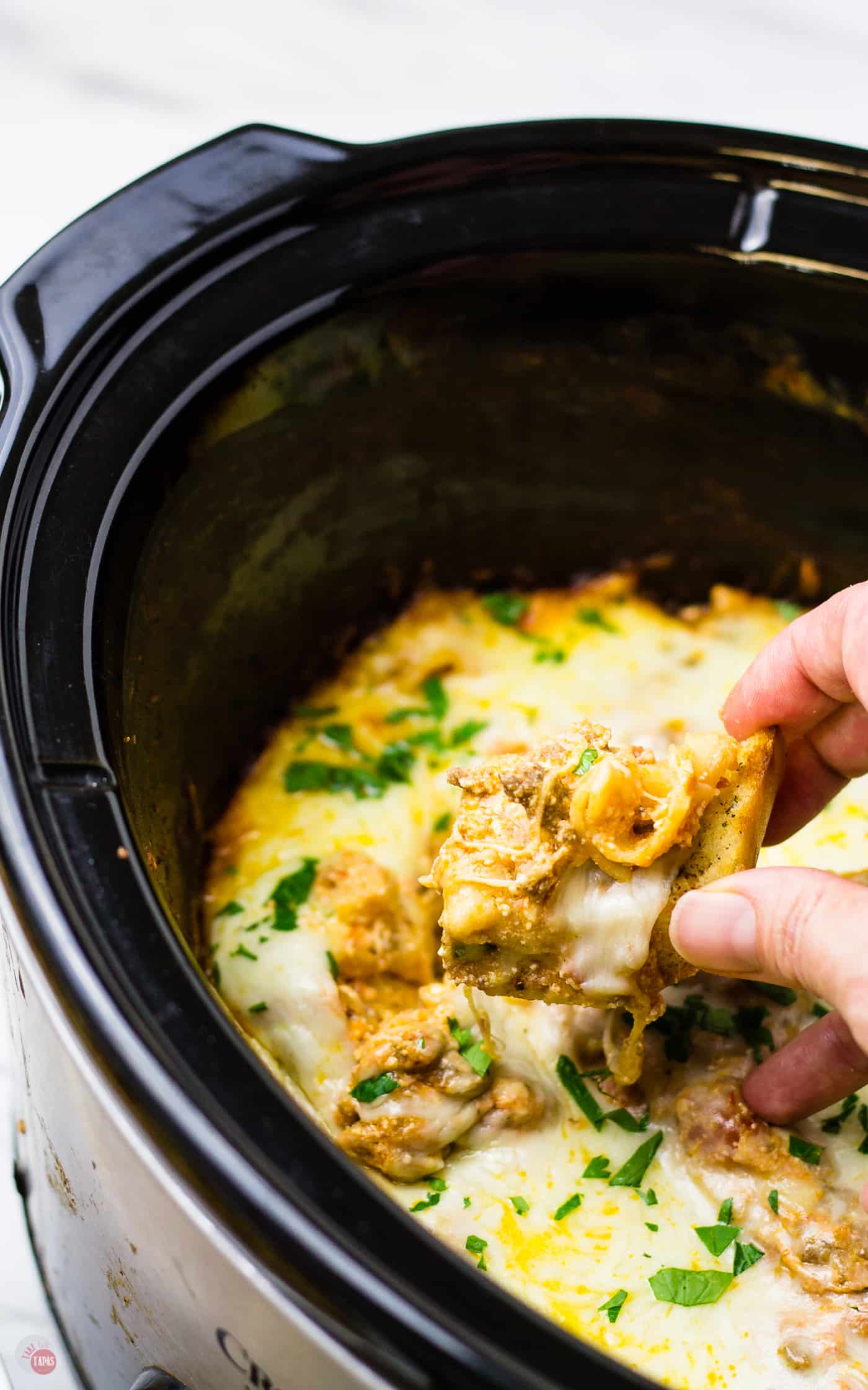 I use garlic bread to scoop up this crockpot lasagna dip