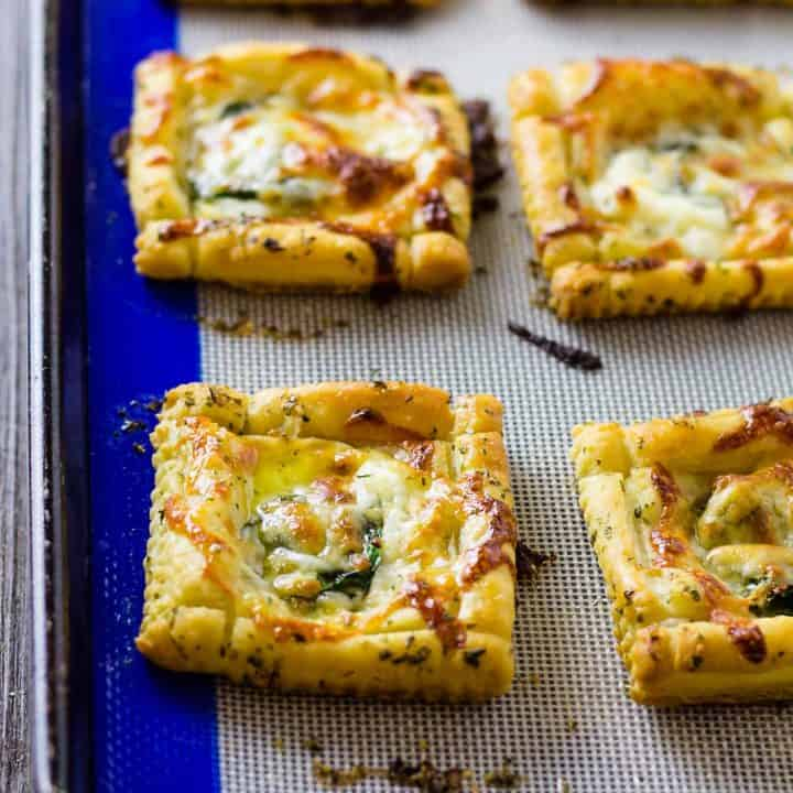 close up of White PIzza Mini Tarts on a sheet pan