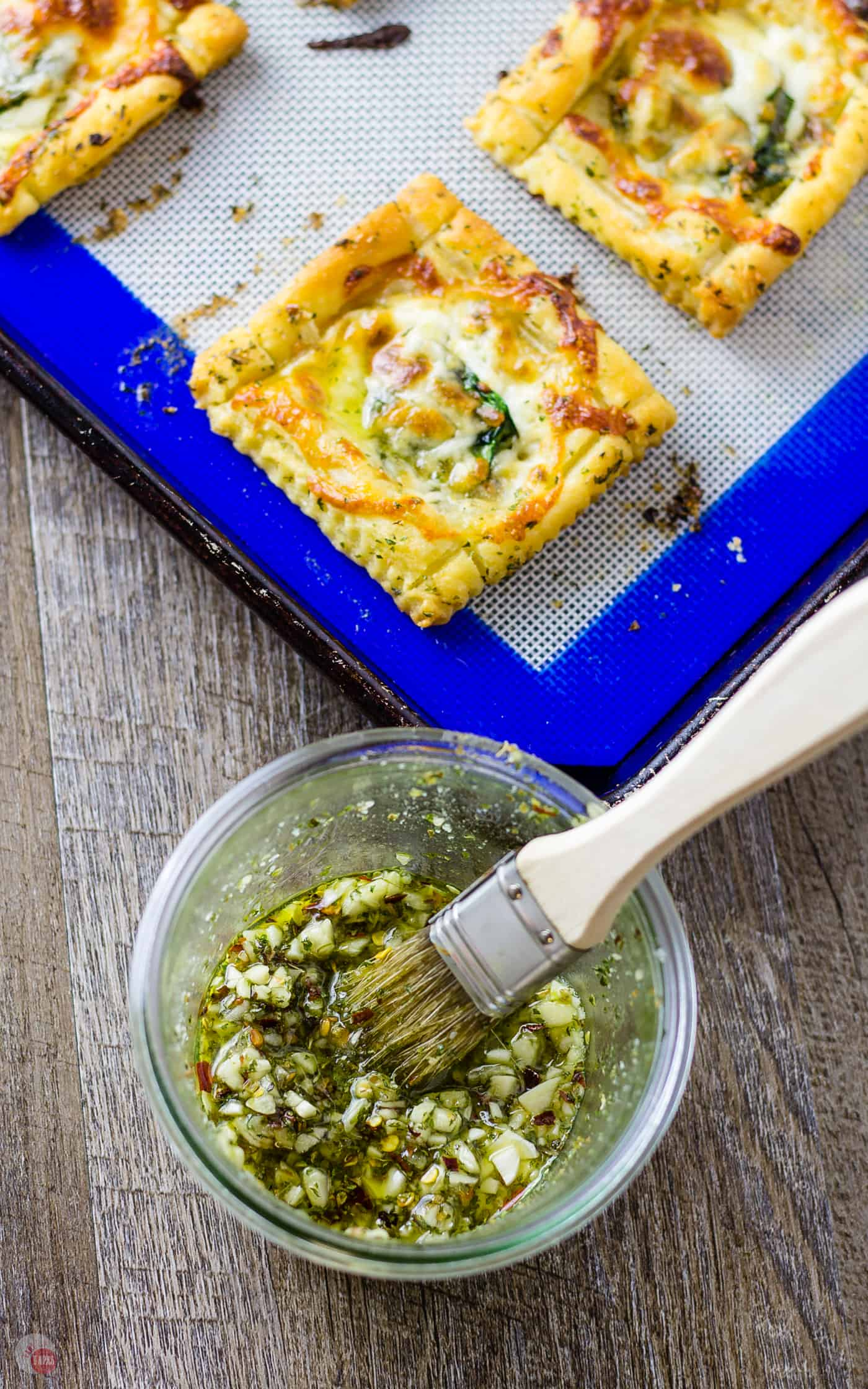 The garlic sauce for my White Pizza Mini Tarts will blow your mind! | Take Two Tapas #pizza #WhitePizza #Tarts
