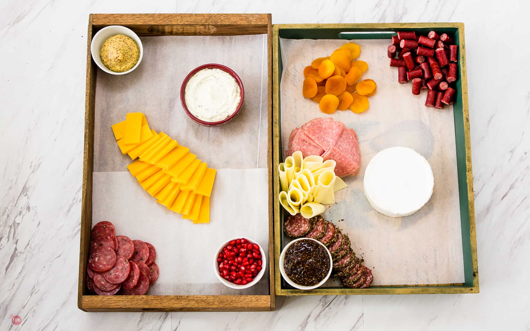 Place your meats spread out on your cheese boards. Cheese Board Tutorial | Take Two Tapas | #cheeseboard #tutorial #appetizer #Cheese #Holiday