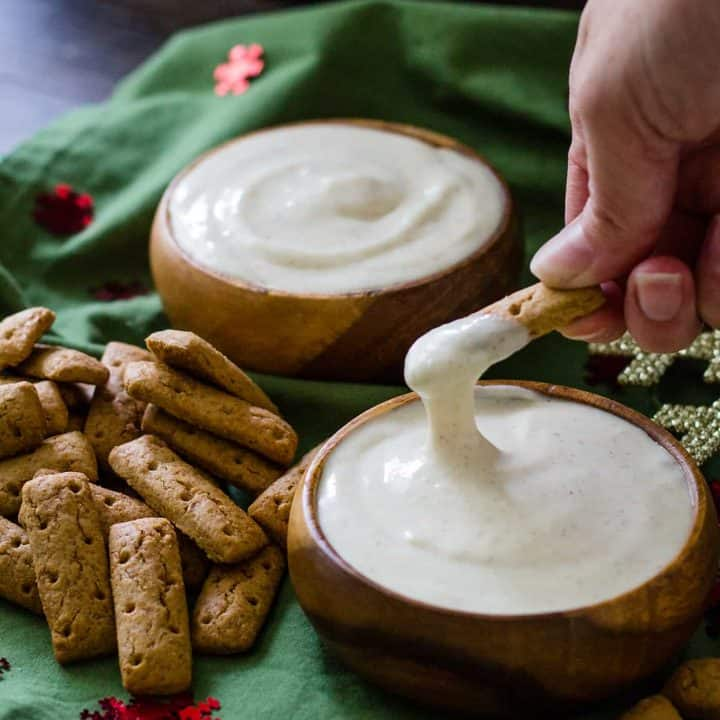 dipping a graham cracker stick in to the spiked eggnog dip.