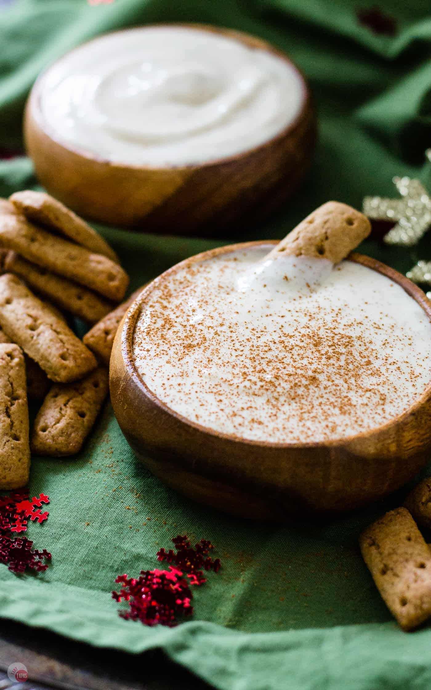 This spiked eggnog dip will be the centerpiece of your holiday party!! | Take Two Tapas | #eggnog #spikedeggnog #dip #Spiked #Christmas #Spikedeggnogdip #Eggnogdip #HolidayRecipes #holidayParty