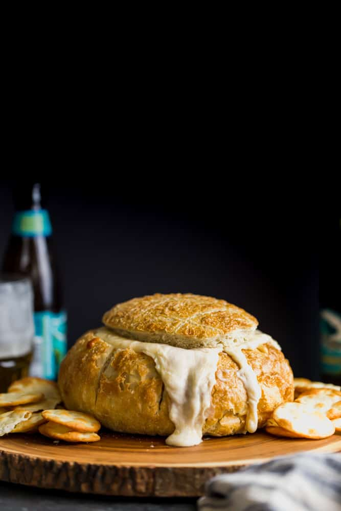 Creamy Beer Cheese Dip Tear apart Bread on the table ready for serving at any game day party!