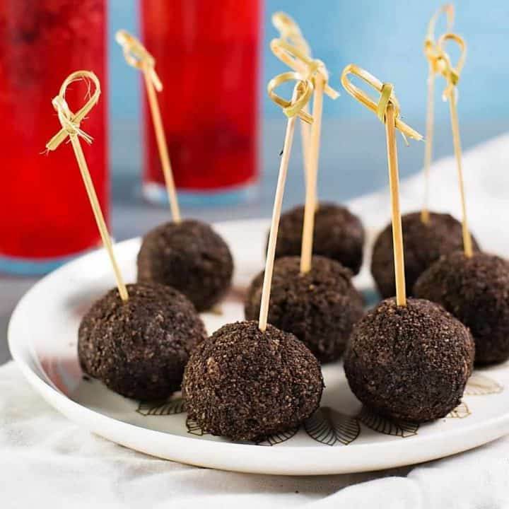 Deliciously Creamy No Bake Chocolate Cheesecake Bites, are perfect for any gathering - from holiday entertaining to party snacking. With a little bourbon, these boozy bite sized treats will be a devoured in minutes!