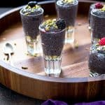 Berry chia dessert pudding shooters on a round tray
