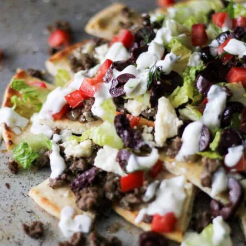 Close up of Greek Gyro Nachos on a sheet pan