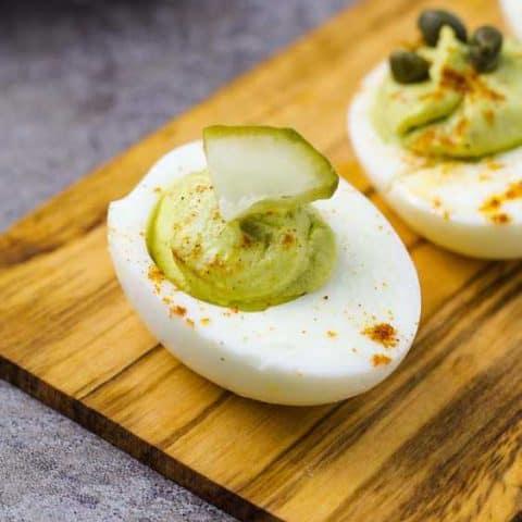 Avocado deviled egg on a cutting board