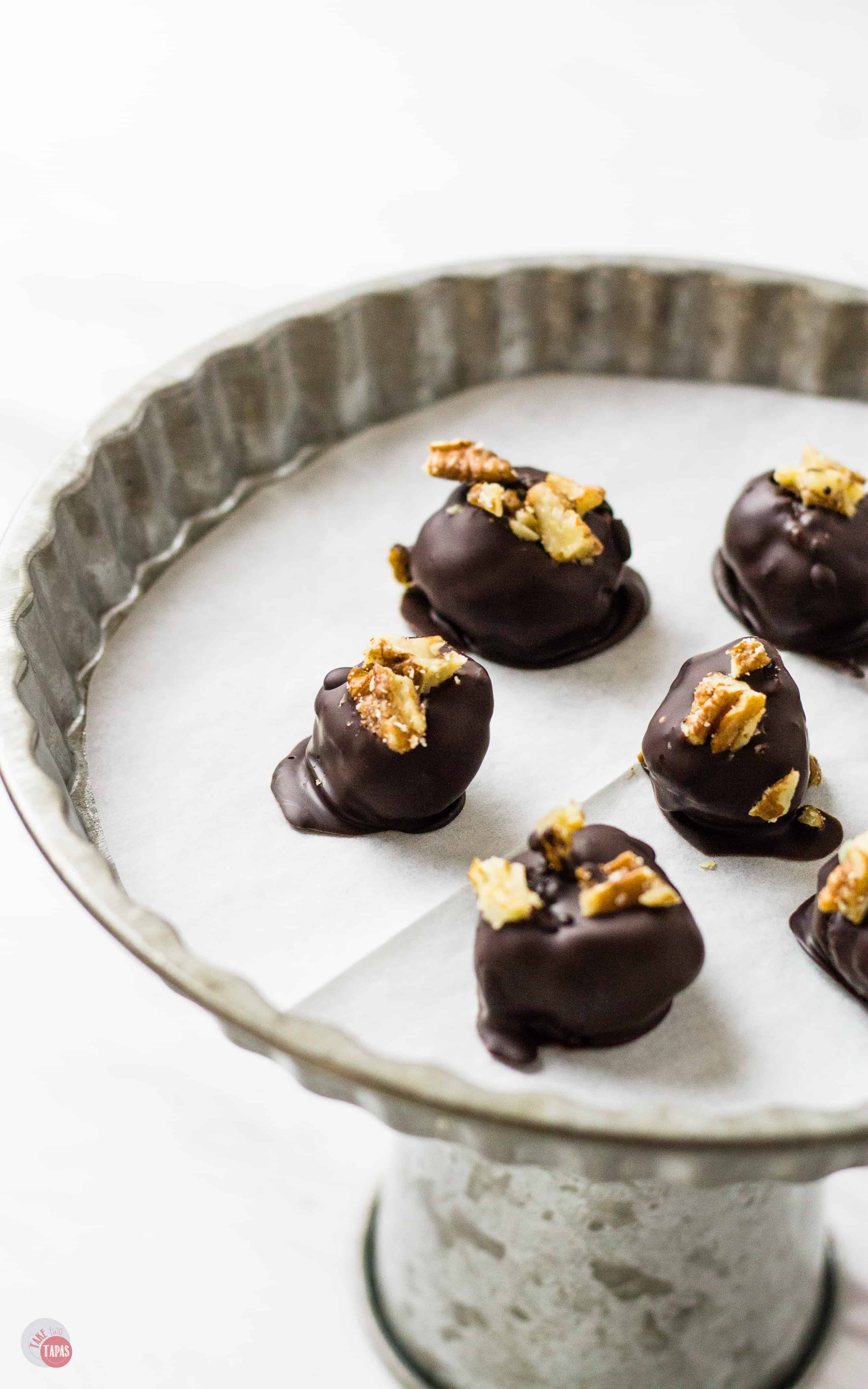 Dark Chocolate Covered Kentucky Derby Pie Bites on a plate