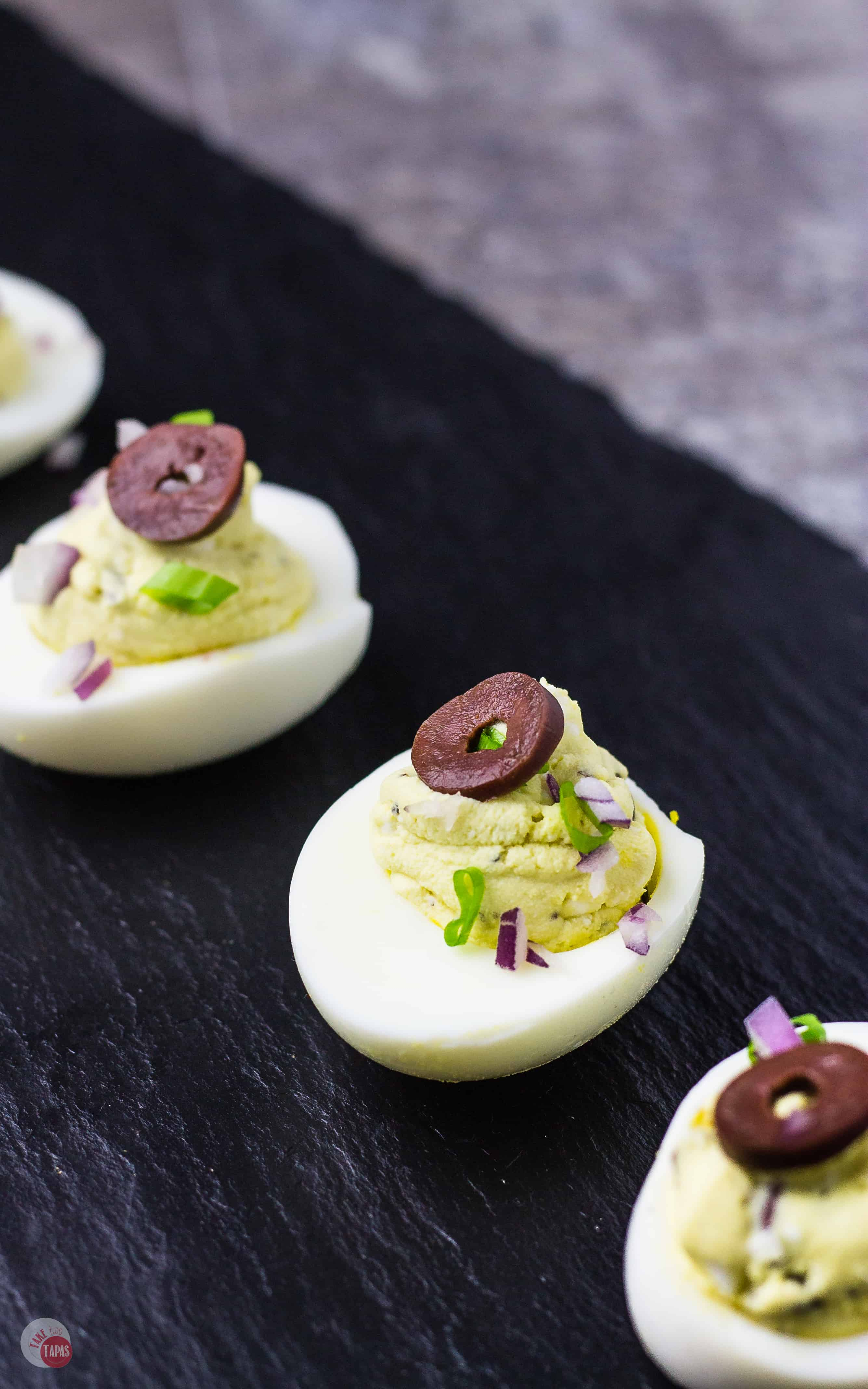 Exotic Flavors in these Mediterranean Deviled Eggs shine with feta | Take Two Tapas | #Mediterranean #Feta #DeviledEggs #Kalamata #Olives #Easter #MothersDay