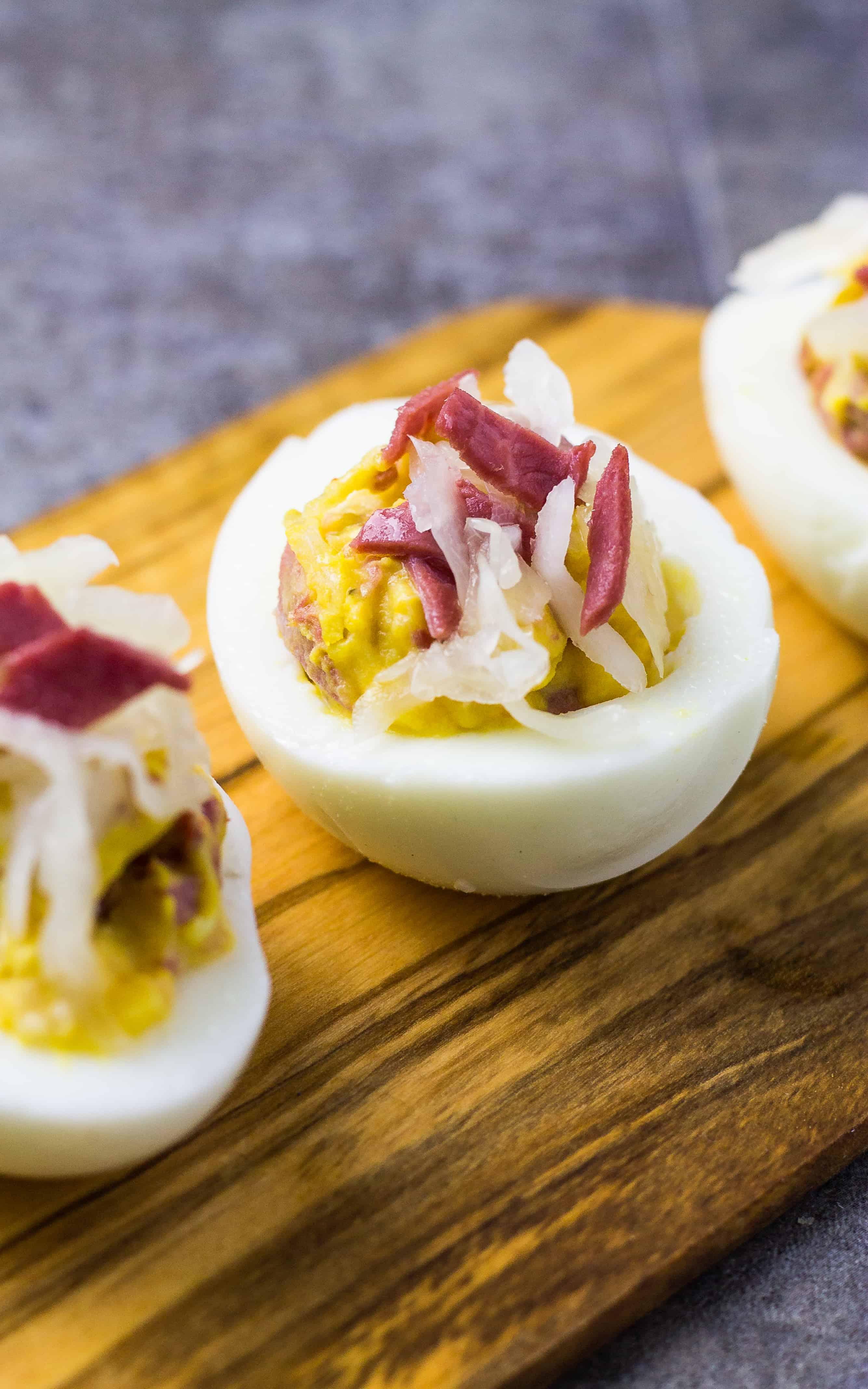 corned beef reuben deviled egg on wood tray