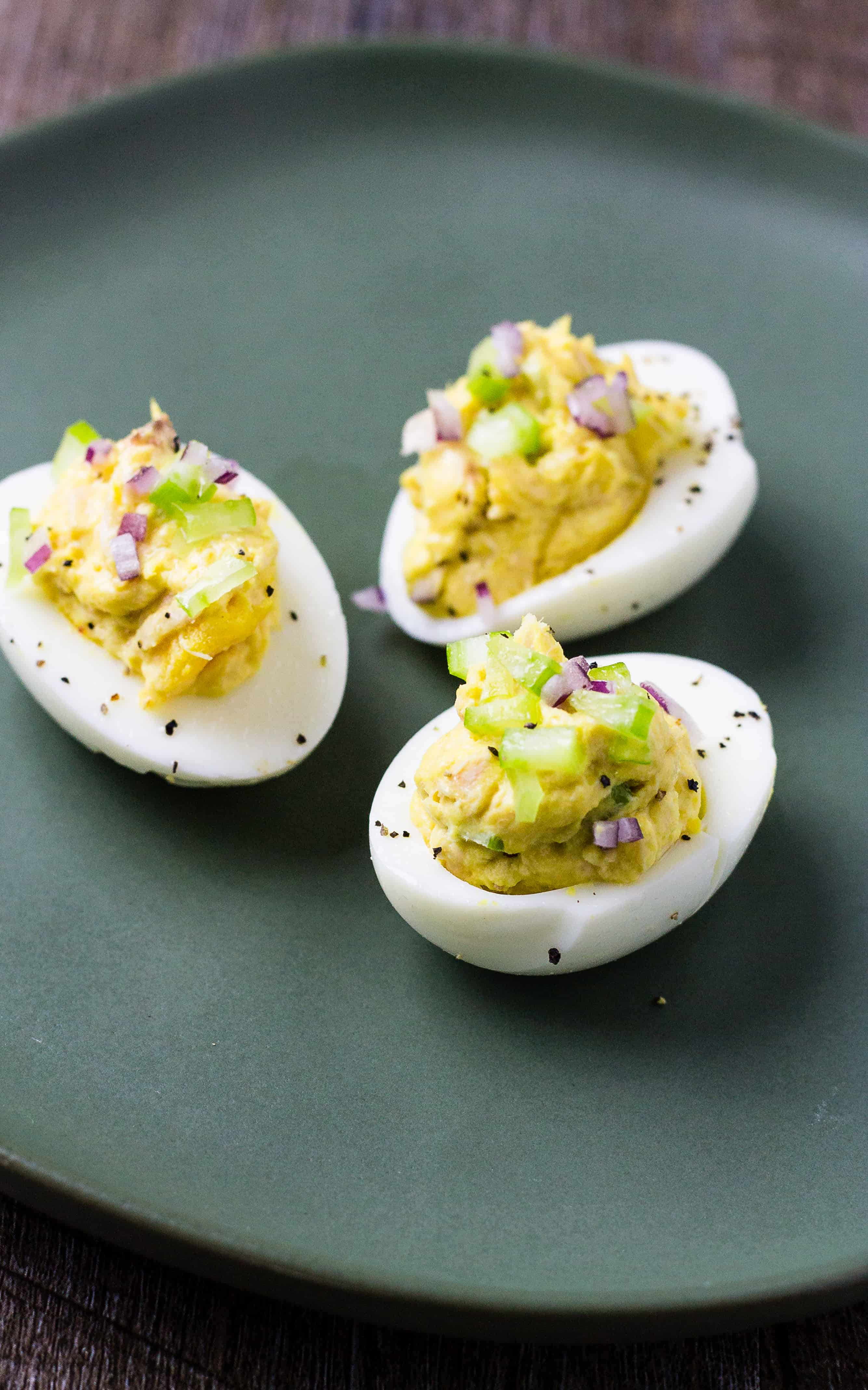 Close up of Tuna Salad eggs on a green plate