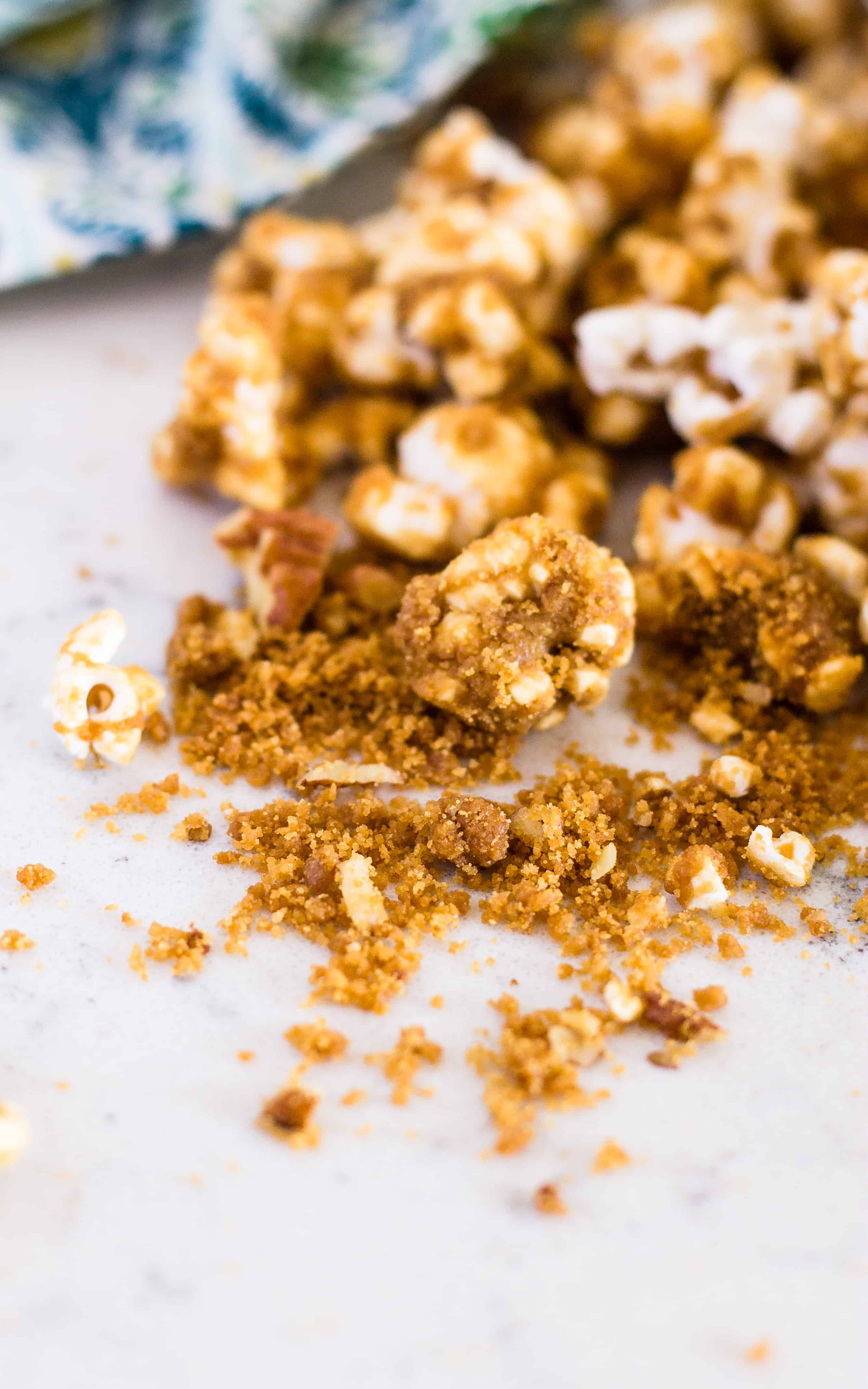 One of the best parts of Grandma's Caramel Corn is the crispy crumbs at the bottom. - caramel corn | Take Two Tapas | #CaramelCorn #PopcornRecipe #CaramelPopcorn #EasyCaramelCorn #SummerSnacks #SnacksToShare #GlutenFreeSnacks