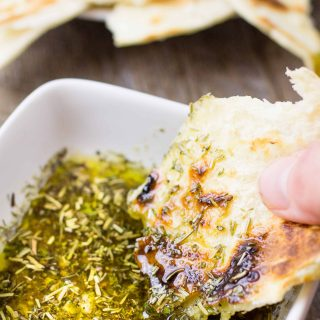 Greek Dipping Oil is light and flavorful. Perfect for an easy bread dipping recipe! | Take Two Tapas | #GreekRecipes #GreekSeasoning #Bread #DippingOil #EasyDippingOil