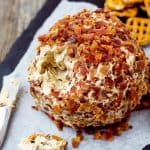 close up of Elvis Cheese Ball and a few dipped pretzels