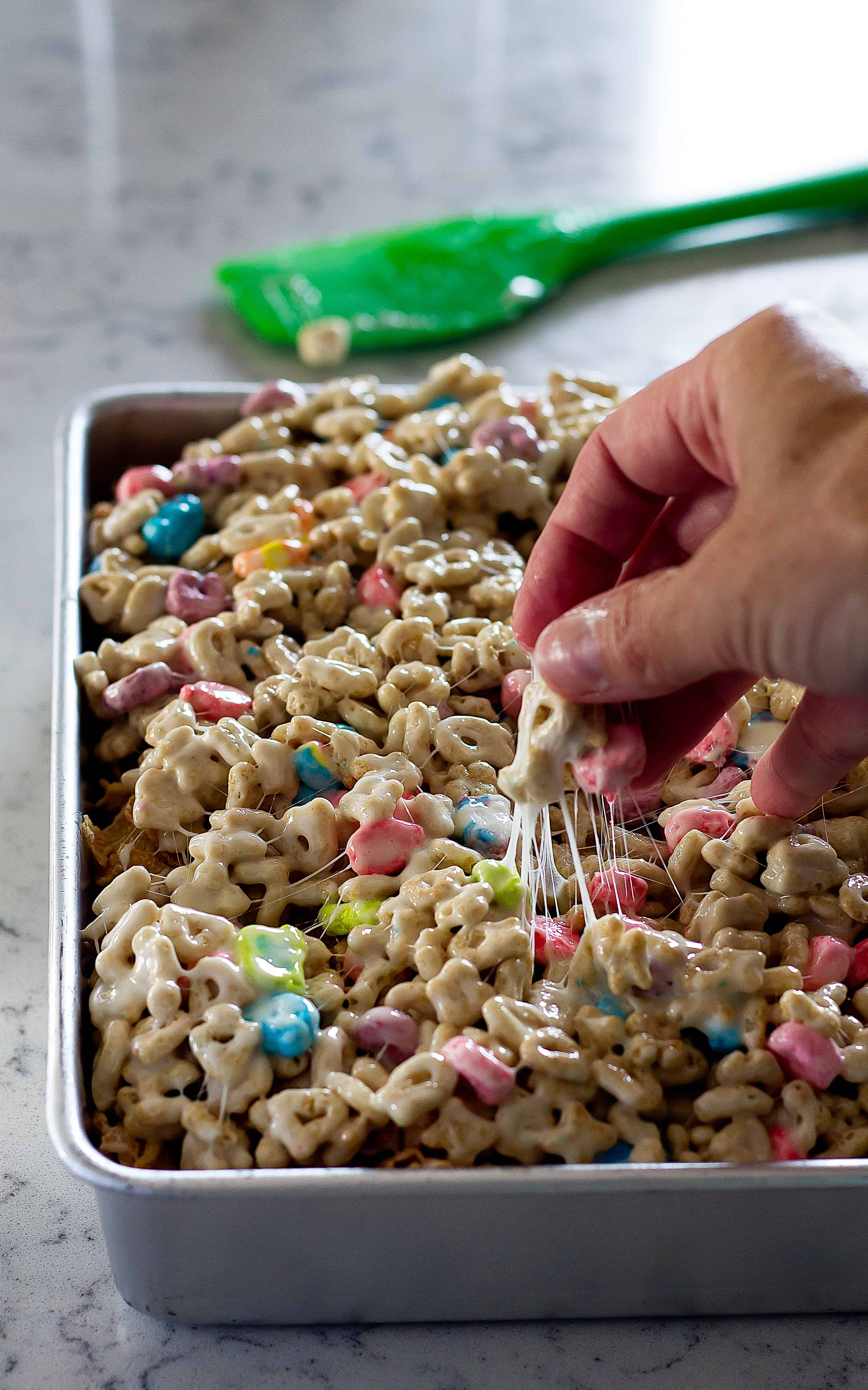 3 layers of your favorite cereals make these Layered Cereal Treat Bars the best! | Take Two Tapas | #CerealBars #KrispiesTreats #FruitLoops #FrostedFlakes #LuckyCharms #CerealRecipes #KidsTreats #AfterSchoolSnacks
