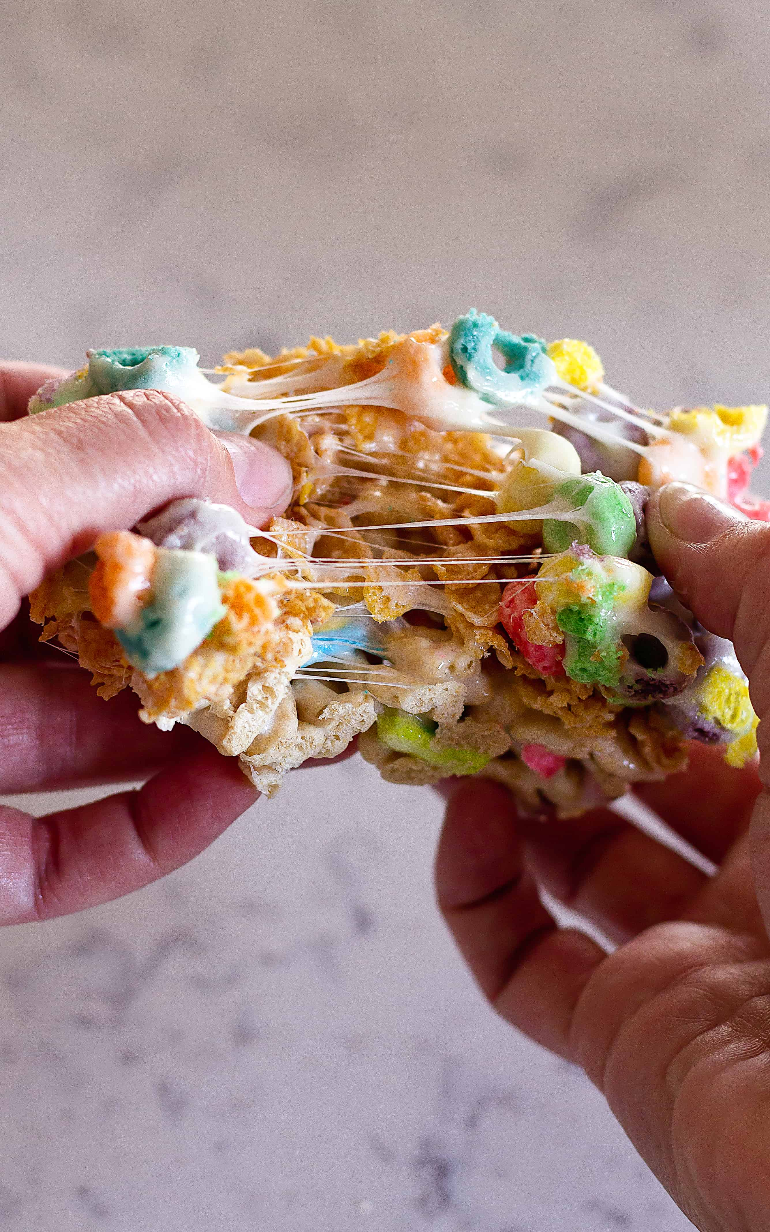Check out the chewy marshmallow in my Layered Cereal Bars | Take Two Tapas | #CerealBars #KrispiesTreats #FruitLoops #FrostedFlakes #LuckyCharms #CerealRecipes #KidsTreats #AfterSchoolSnacks