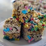 A smaller deeper pan works best to showcase the layers of cereal! Layered Cereal Treat Bars | Take Two Tapas | #CerealBars #RiceKrispiesTreats #FruitLoops #FrostedFlakes #LuckyCharms #CerealRecipes #KidsTreats #AfterSchoolSnacks