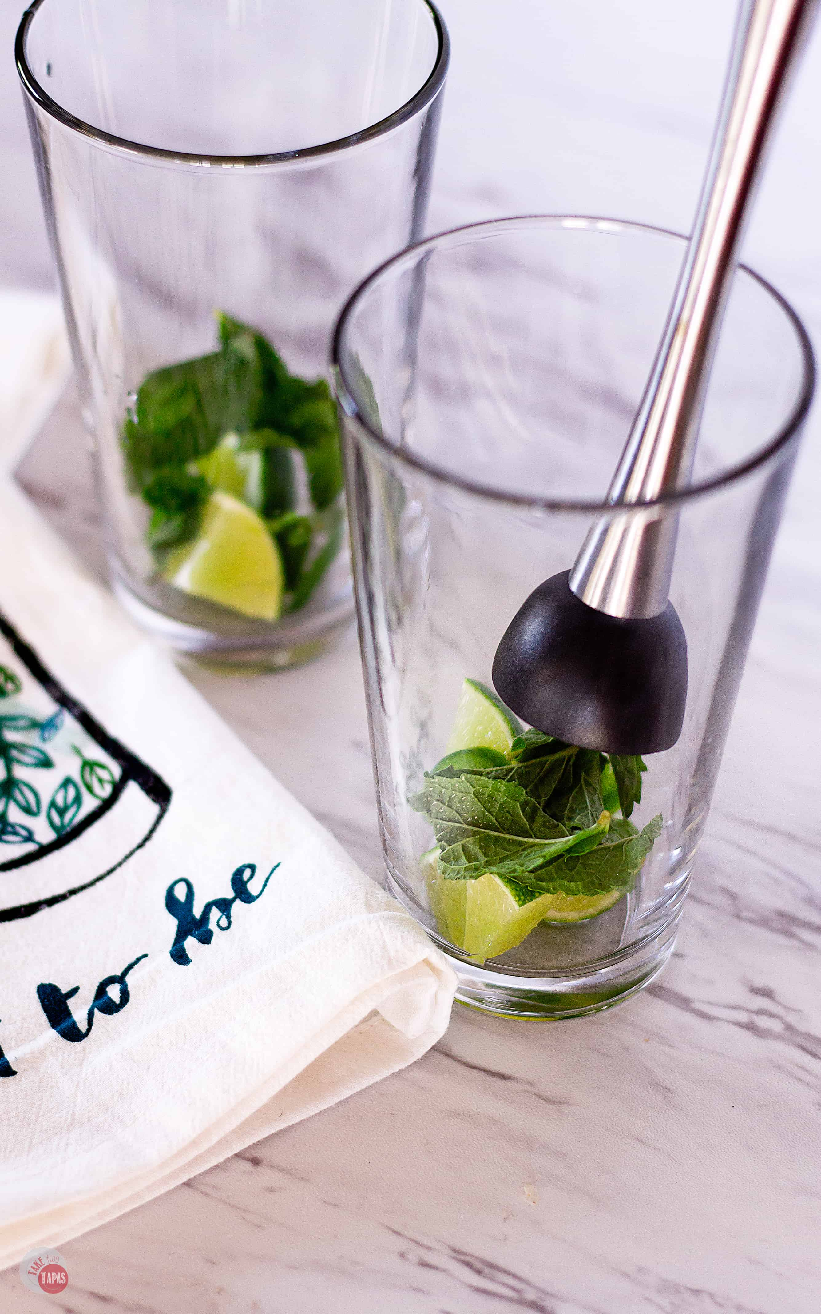 Muddle some mint and lime for this Spicy Jalapeño Mojito Recipe | Take Two Tapas | #MojitoRecipe #RumCocktail #Mint #JalapeñoRecipe #CocktailRecipes