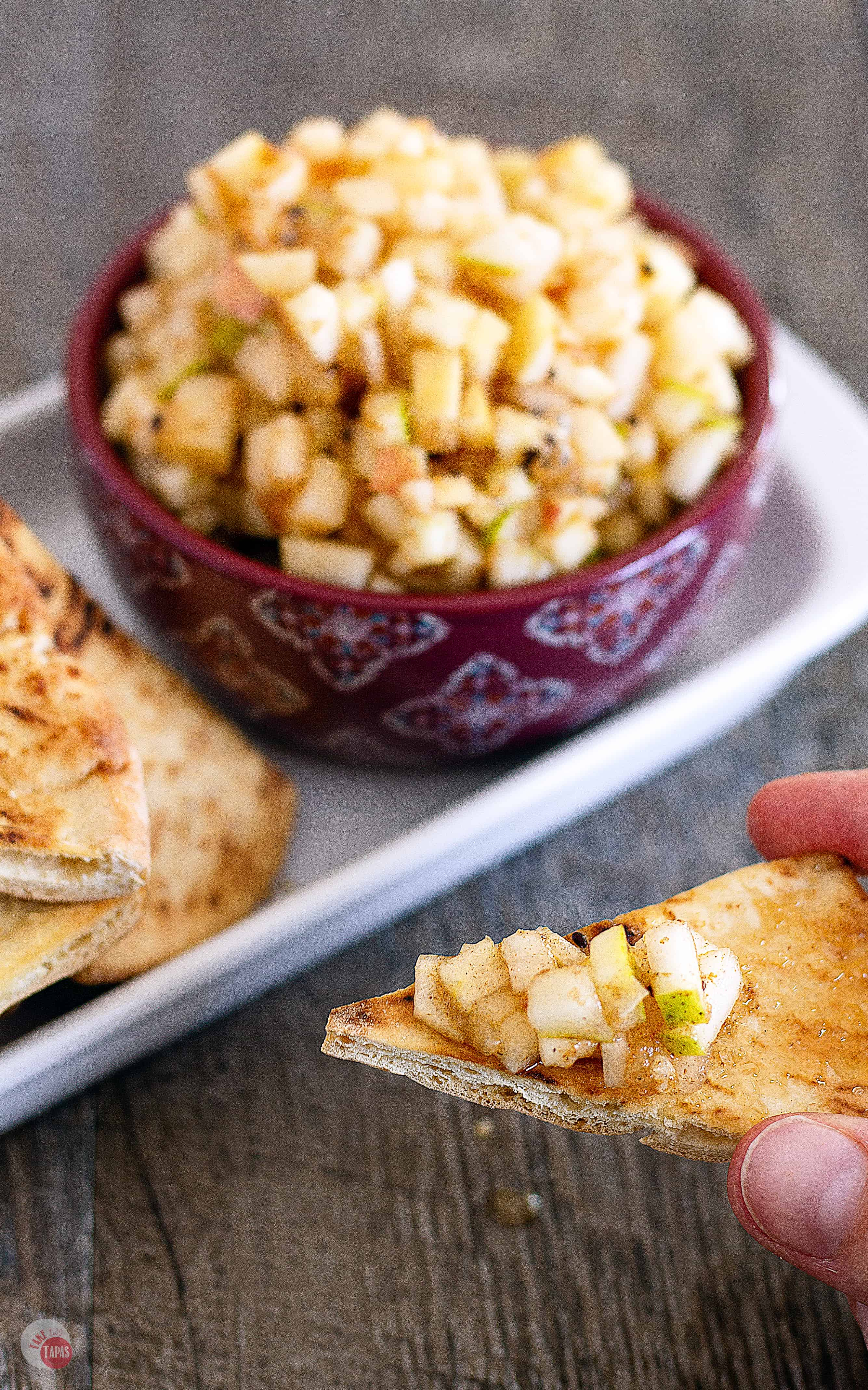 The best way to eat this fresh apple pie salsa is with cinnamon sugar dusted baked pita chips! | Take Two Tapas | #ApplePieSpice #ApplePie #SalsaRecipe #AppleRecipe
