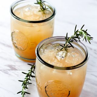 This Grapefruit Rosemary Rum Punch is the perfect combination of tart and herbal. The perfect cocktail for your holiday party! | Take Two Tapas | #Grapefruit #Rosemary #RumPunch #RumCocktails