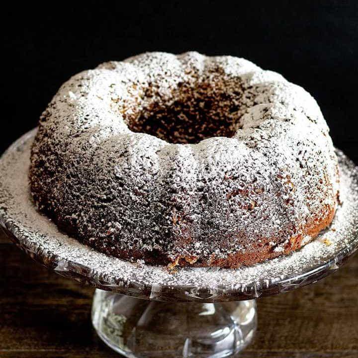 Louisiana Stranger Cake Bundt Cake on a glass cake platter