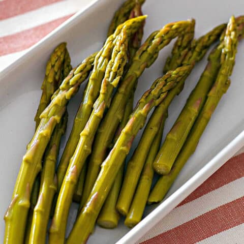 close up of pickled asparagus spears