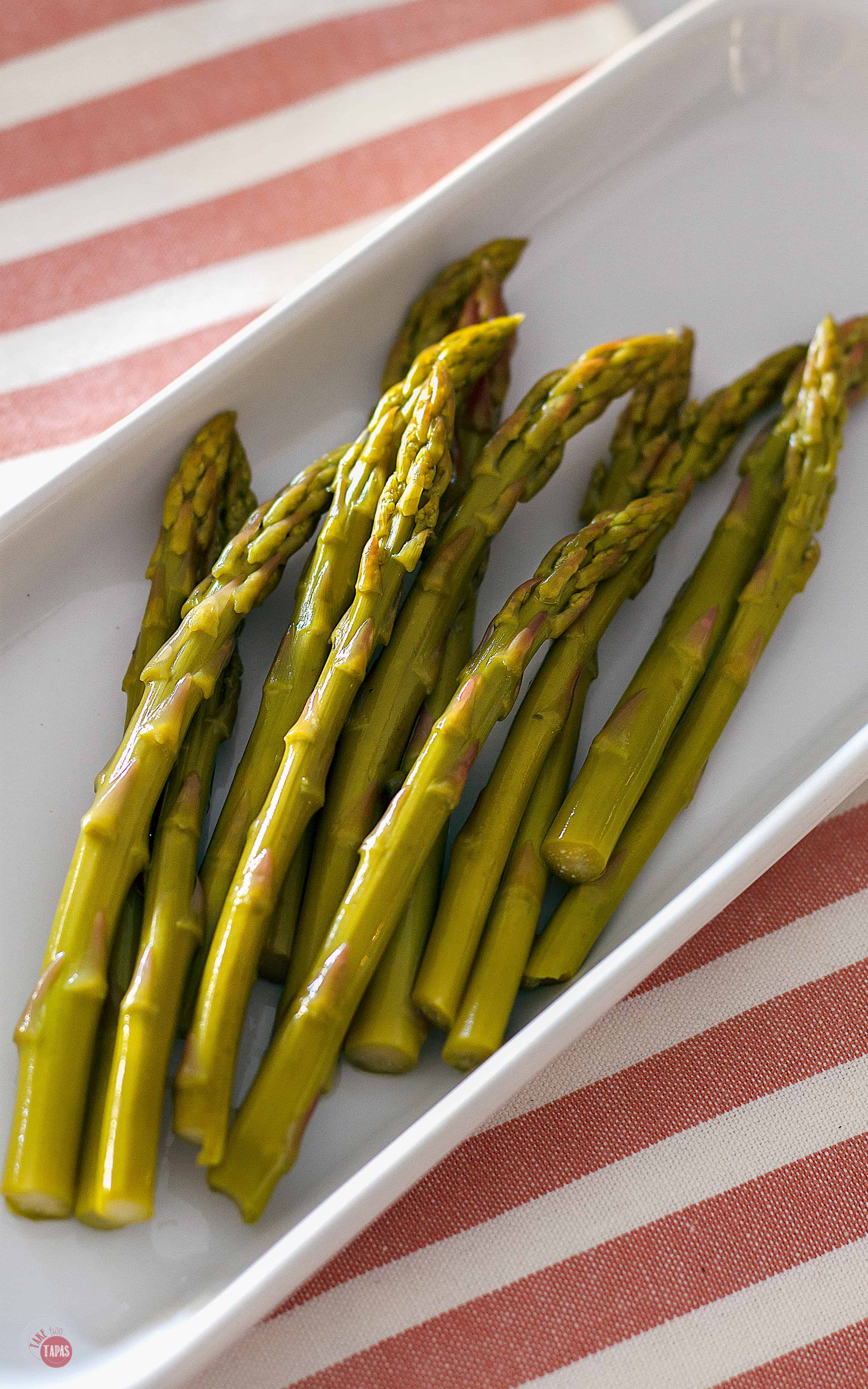Asparagus pickles on a white tray