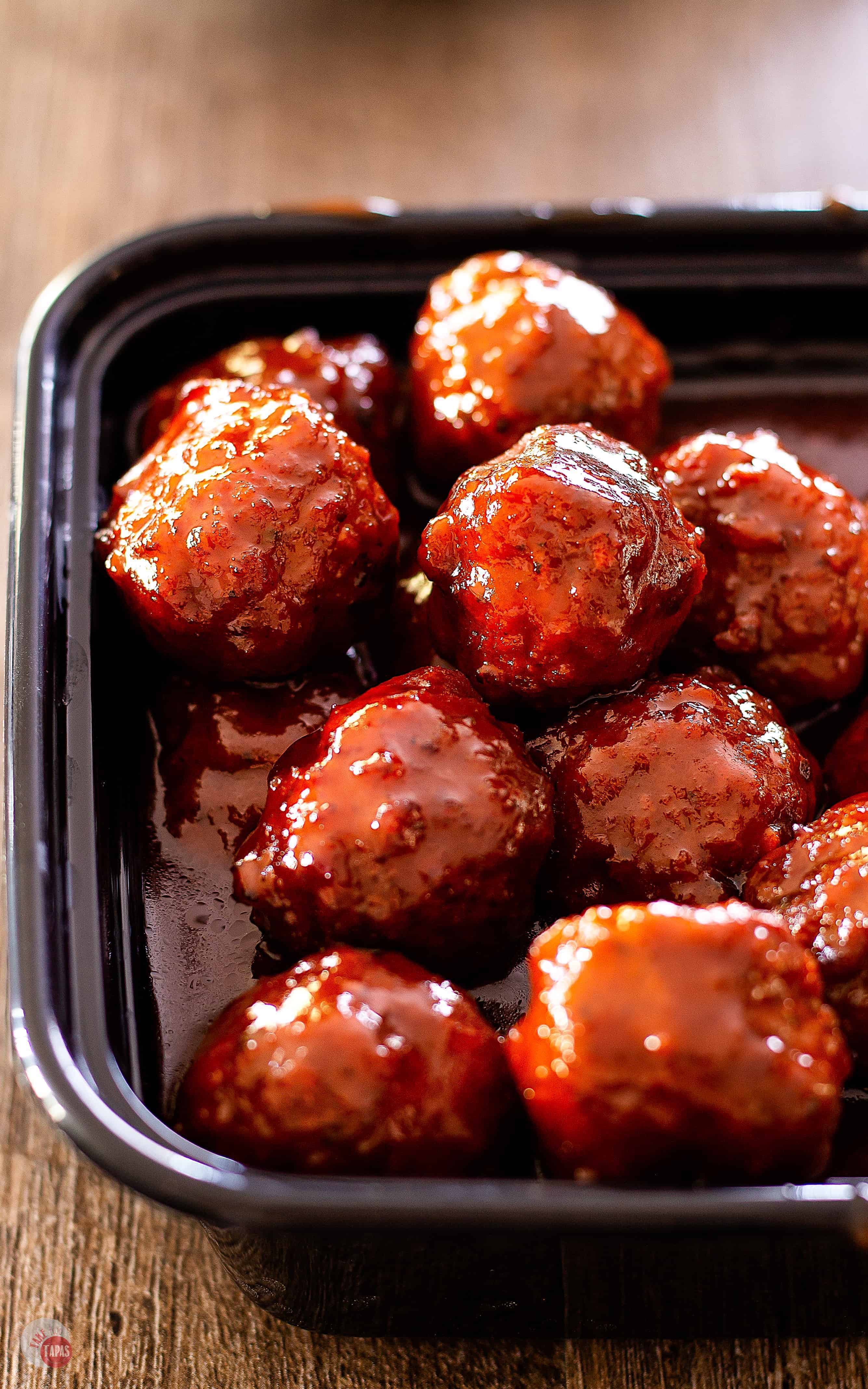 Tangy sweet crockpot meatballs easy to prep and are hands-off in the crockpot!! | Take Two Tapas | #CrockpotMeatballs #InstantPotMeatballs #PartyMeatballs