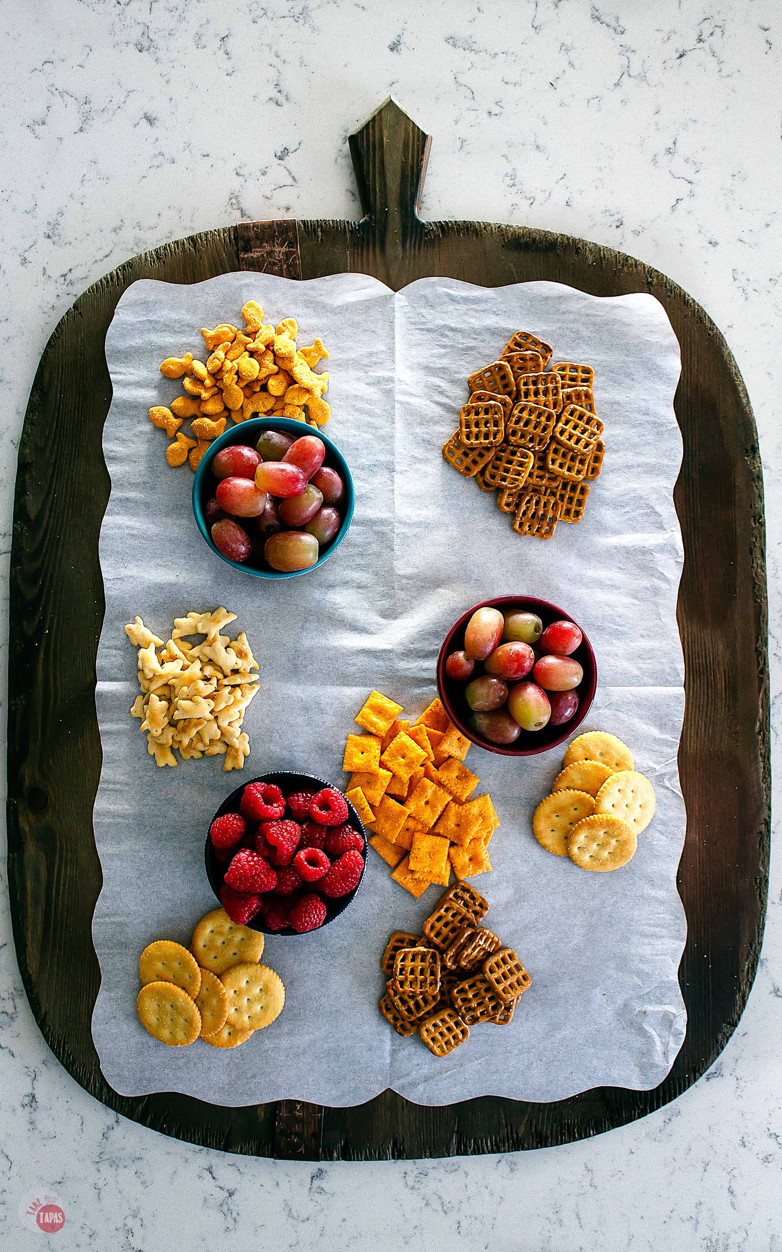 crackers and fruit on a platter