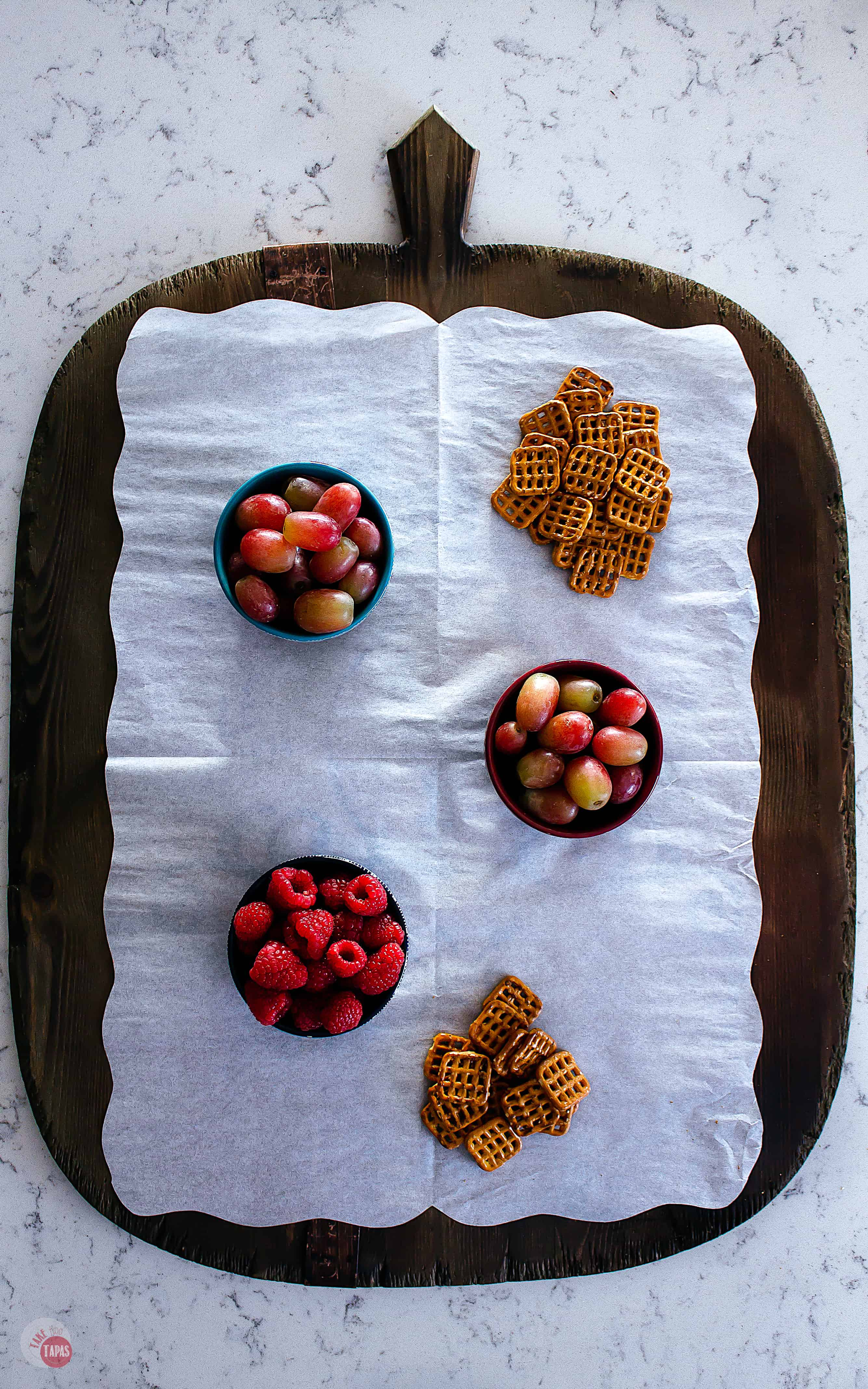 platter with fruit and pretzels