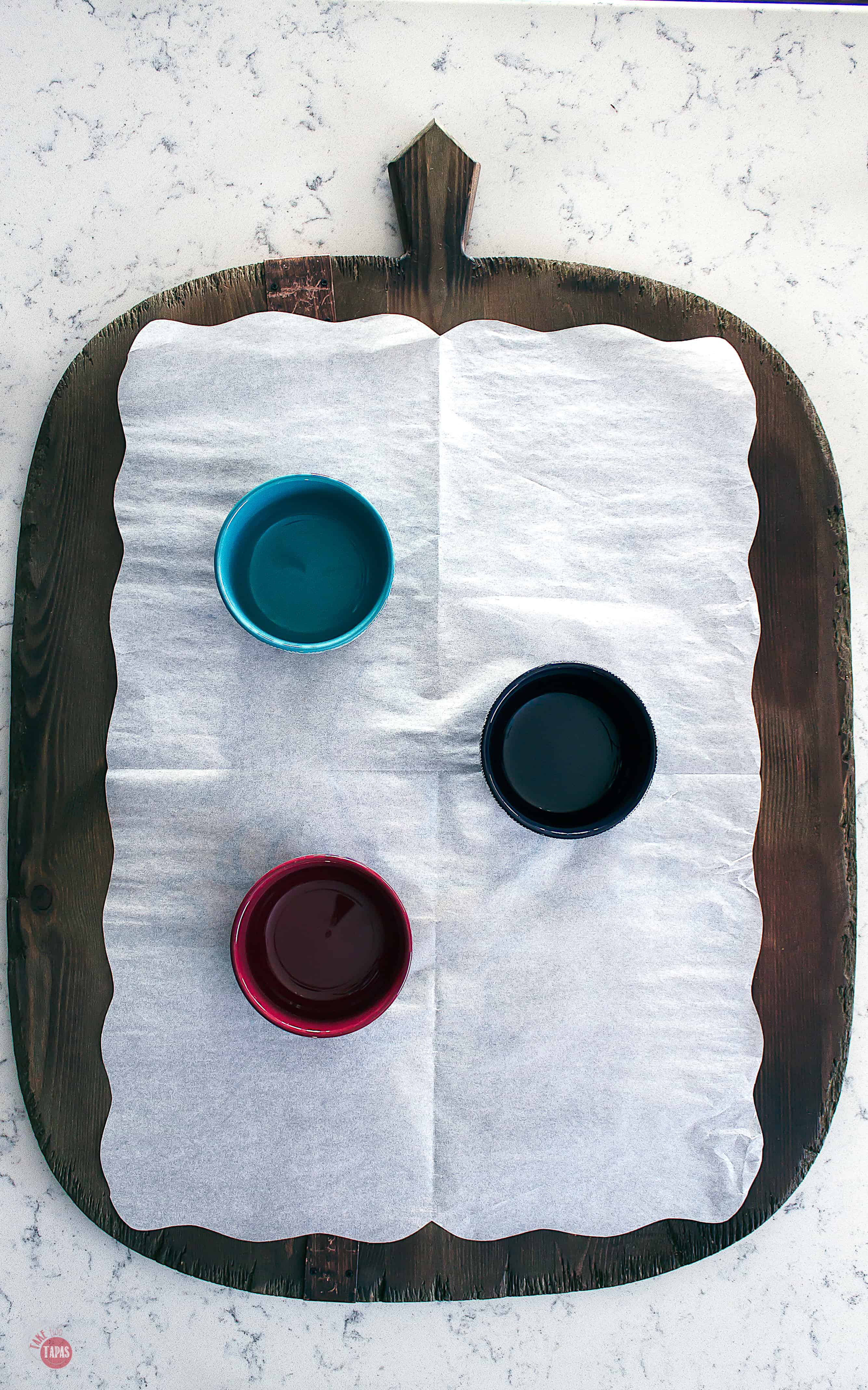parchment paper and bowls on a platter