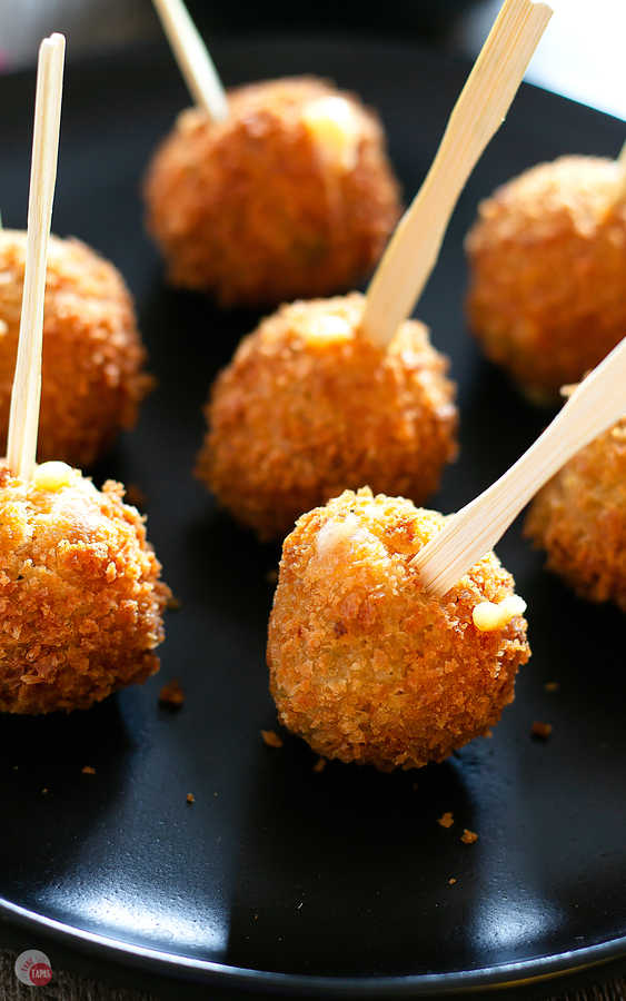 Serve these Fried Cornbread Dressing Balls on mini forks! | Take Two Tapas | #ThanksgivingLeftovers #StuffingRecipe #Appetizer