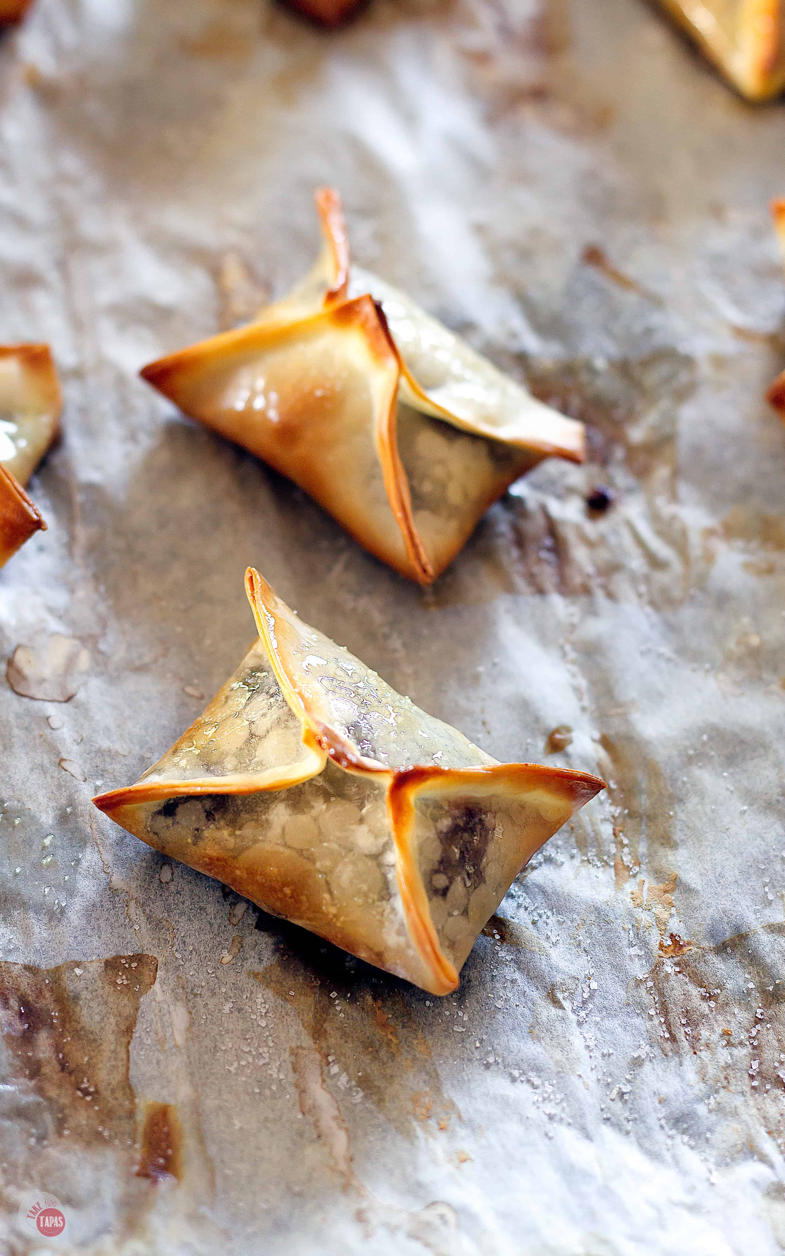 wonton on parchment paper just out of the oven