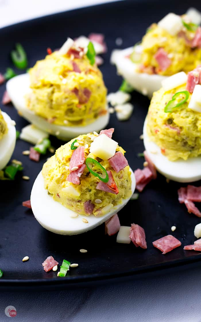 Spicy capicola and olive salad make these Muffuletta Deviled Eggs over the top! | Take Two Tapas | #Muffuletta #DeviledEggs #MardiGras