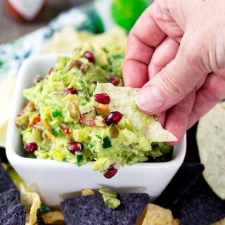 Sweet and Spicy Pomegranate Guacamole | Take Two Tapas | #Guacamole #Pomegranate #SavorWinningFlavors #AvocadosFromMexico #HAVEARITA #FlavorYourWorld