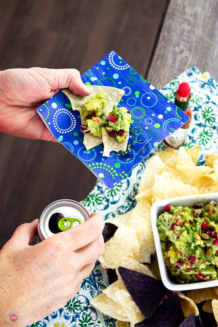 Sweet and Spicy Pomegranate Guacamole is the perfect way to start a party with creamy avocados and tart pomegranate seeds. | Take Two Tapas | #Guacamole #Pomegranate #SavorWinningFlavors #AvocadosFromMexico #HAVEARITA #FlavorYourWorld