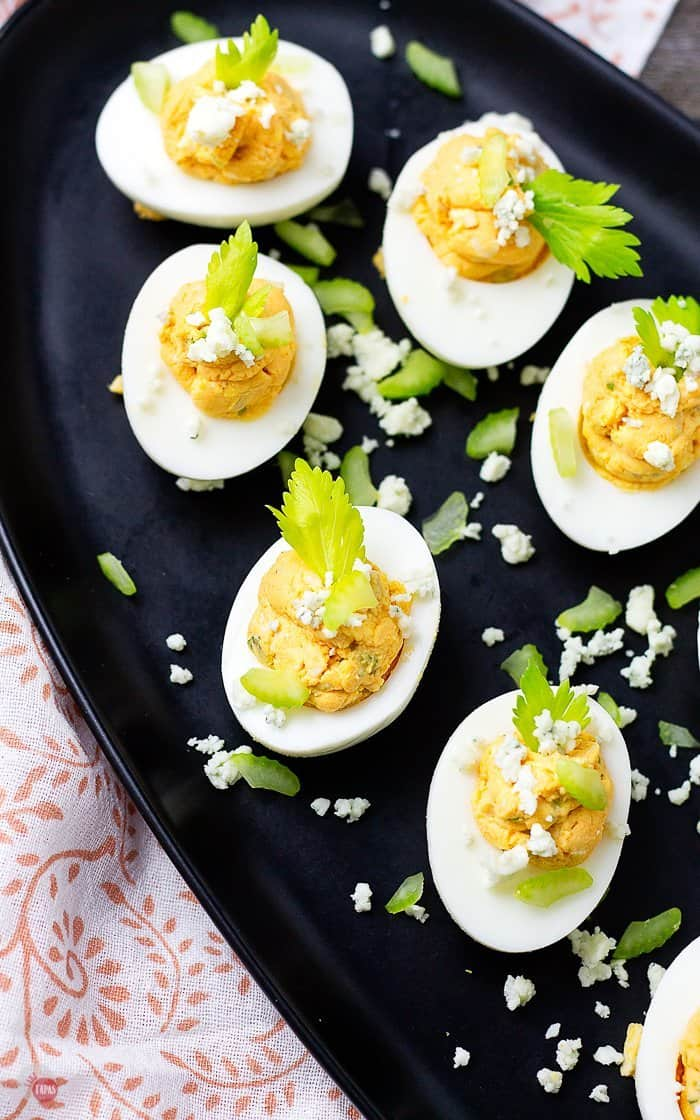 Buffalo Chicken Deviled Eggs can have ranch or blue cheese! #buffalodeviledeggs #buffalochicken