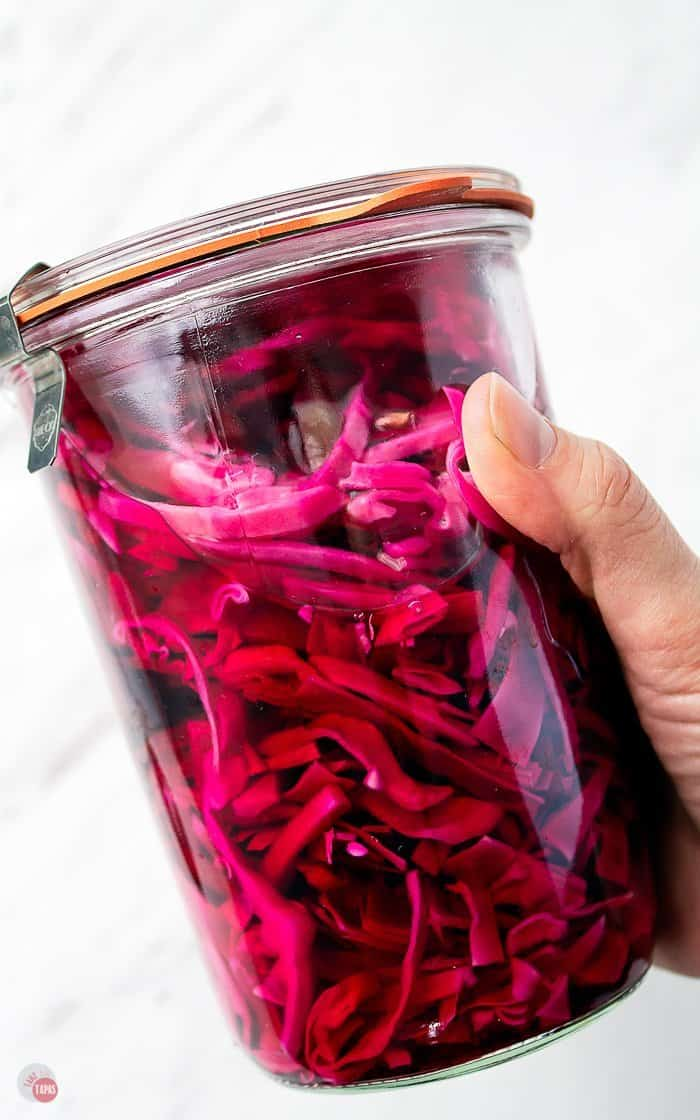 side picture of a jar of pickled purple cabbage