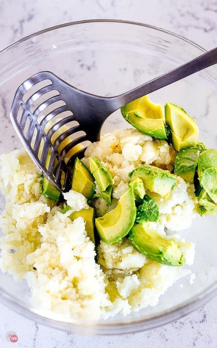 An avocado mixed with the cooked potato make these Taco Tater Tots extra creamy! #tatertots #potatotots