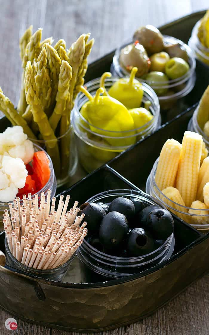 Close up of olives and toothpicks on a relish tray