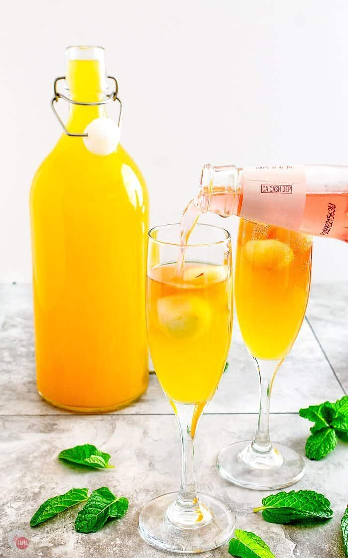 pouring Rosé Hard Cider into the cider mimosa